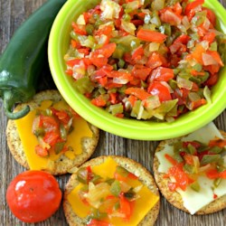 Quick Pickled Pepper Onion Relish Recipe - Peppadew(R) peppers combine their sweet-hot flavor with sauteed onions and jalapenos to create this delicious quick pickled relish.