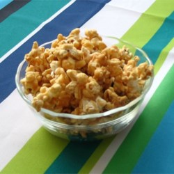 Peanut Butter Popcorn Recipe - Popcorn is coated in a peanut butter and marshmallow mixture that is sweetened with a little brown sugar. A simple treat that doesn't require the stove.