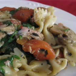 Bow Tie Tuna Florentine Recipe - A classy version of tuna casserole. A creamy pesto sauce with spinach, bow tie pasta and tuna.  Serve with warm French bread and wine for an elegant 'hot dish.'