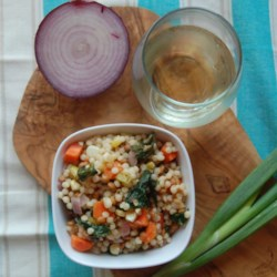 Pearl Couscous with Lentils, Carrots, Spinach, and Corn Recipe - Fresh corn, carrots, and spinach leaves plus tender lentils add flavor and heartiness to a side dish of pearl couscous that can be served warm or cold.