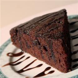 Chocolate Oil Cake Recipe - No butter, just oil in this recipe that delivers a rich, chewy, and chocolate-y cake in about an hour.