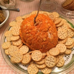 Susan's Smokey Salmon Ball Recipe - Flakes of salmon are found throughout this cheese ball flavored with lemon juice, horseradish, onion, and liquid smoke.