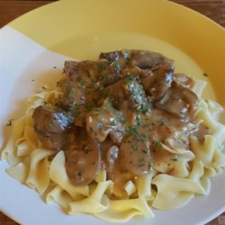 Rich and Creamy Beef Stroganoff Recipe - This recipe uses a roux to create a beef gravy that is then thickened with sour cream and cream cheese.  Red pepper flakes add a little extra zip.