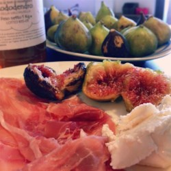 Prosciutto and Figs with Goat Cheese Recipe - Figs are wrapped in goat cheese and prosciutto and baked into sweet and savory appetizers everyone will love.