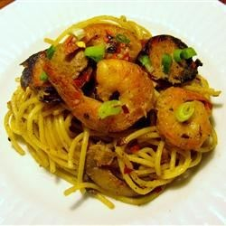 Shrimp and Andouille Sausage with Mustard Sauce Recipe - Sauteed shrimp and spicy sausage are served in a creamy mustard sauce over angel hair pasta.