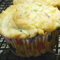 Savory Cheddar Zucchini Muffins Recipe - Savory zucchini muffins made with Cheddar and Parmesan cheese have an extra flavor burst of bacon.