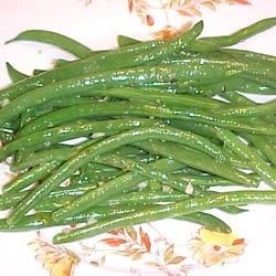 Green Beans with Herb Dressing Recipe - Fresh green beans are covered in an olive oil, green onion and herb dressing.