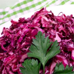 Red Cabbage Salad II Recipe - Colorful, crisp red cabbage is tossed with a delightful oil and vinegar dressing.