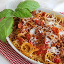 German Spaghettini Recipe - A hearty and flavorful beef, sausage, bacon and tomato sauce baked with spaghettini. Spaghettini is a thinner version of spaghetti.