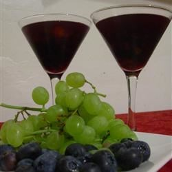 Sangria II Recipe - Red wine and soda with citrus fruits and cherries in a sweet Spanish-style punch.