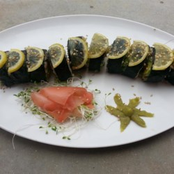 Avocado Sushi with Brown Rice Recipe - Short grain brown rice, avocado, red bell pepper, and alfalfa sprouts are rolled in nori seaweed sheets for a delicious vegetarian sushi roll.