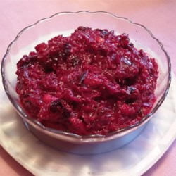 Beet Salad Recipe - Grated beets mingle with walnuts, prunes, and pickles in mayonnaise for a sweet-and-savory cold salad.