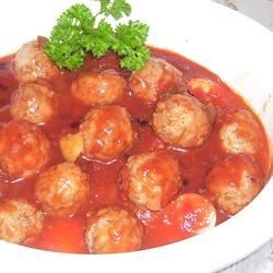 Slow Cooker BBQ Meatballs and Polish Sausage Recipe - Meatballs and kielbasa cook together in a creative sauce in this slow cooker appetizer.