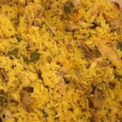 Easy Chicken and Yellow Rice Recipe - Packaged yellow rice becomes an easy meal with seasoned chicken breast.