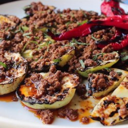 Grilled Pattypan Squash with Hot Chorizo Vinaigrette Recipe - Top grilled pattypan squash with a delicious hot chorizo sausage vinaigrette for an easy summery meal.