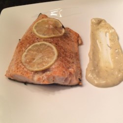 Scott's Grilled Salmon Recipe - Grilled salmon with plenty of lemon is topped with a creamy garlic sauce in this dinner perfect for summer nights.