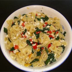 Sweet Pepper Pasta Toss with Kale Recipe - Sauteed sweet peppers and kale are tossed with farfalle pasta and sprinkled with a generous amount of crumbled feta cheese. This recipe was inspired by a similar recipe I received in my produce box from Full Circle Farm in Carnation, WA.