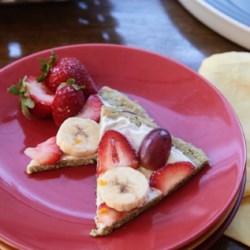 "Zucchini Bread Breakfast Pizza Recipe - Zucchini bread is the ""crust"" in this zucchini bread breakfast pizza layered with Greek yogurt, fruit, and maple syrup."