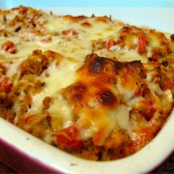 Bruschetta Chicken Bake Recipe - A simple, delicious chicken-and-stuffing casserole made with chicken breasts, tomatoes, Italian seasonings, and mozzarella cheese.