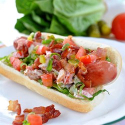 BLT Dogs Recipe - Two sandwich favorites, the BLT and hot dogs, come together in this recipe for BLT dogs that are a fun summertime meal.