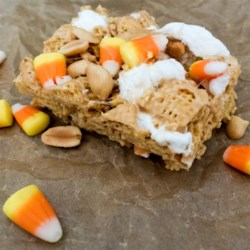 Peanutty Candy Corn Cereal Bars Recipe - Fold your leftover candy corn and peanuts into marshmallow cereal bars for a colorful and crunchy treat around Halloween.