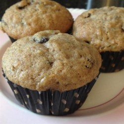 Zucchini Raisin Muffins Recipe - Zucchini and raisins keep these muffins moist and sweet for a quick breakfast bread for those on-the-go mornings.