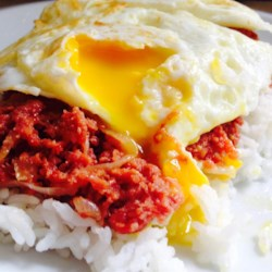 Corned Beef Hash (Abalos style) Recipe - Corned beef, potatoes, tomatoes, onions, and tons of garlic make this Filipino family recipe an excellent quick and easy dish to serve over rice.