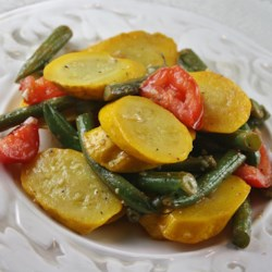 Squash and Green Bean Saute Side Dish Recipe - Squash and green beans are pan-fried in a lemon-based sauce creating a quick and easy side dish.