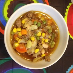 Ground Beef and Vegetable Soup Recipe - Plenty of veggies and beans pack this ground beef and vegetable soup with complex flavor, making it a definite crowd-pleaser.