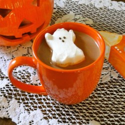 A Spiritful Hot Chocolate Recipe - Dress up your hot chocolate for Halloween! Add a little brandy and float a ghost-shaped marshmallow on top of your mug of hot chocolate.