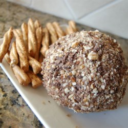 Chocolate Chip Cheese Ball Recipe - A sweet switch from the usual cheese ball. Cream cheese and butter are sweetened and blended with miniature chocolate chips, then rolled in chopped pecans.