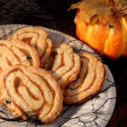 Oats and Pumpkin Pinwheels Recipe - Pinwheel cookies with a pumpkin filling and sesame seed coating.