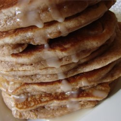 Cinnamon Griddle Cakes Recipe - A yummy and simple breakfast food, and a simple substitute to making cinnamon rolls. Delicious cinnamon biscuits that are baked on the griddle!