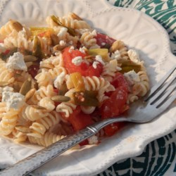 Pumpkin Seed Pasta Recipe - Roasted pumpkin seeds provide a spicy crunch on top of gemelli pasta sauced with roasted garlic roma tomatoes and goat cheese.