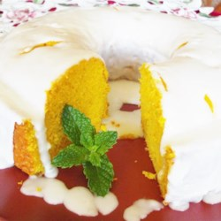 Easy Mango Cake Recipe - This moist and easy mango cake is the result of yellow cake mix and mango baked together and topped with homemade mango glaze.