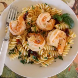 Shrimp Scampi with Sun-Dried Tomatoes Recipe - This shrimp scampi recipe features sun-dried tomatoes in the sauce, making a delightful treat for the eye and the palate.