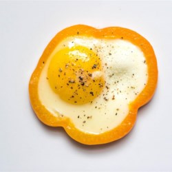 "Egg in a Pepper Recipe - An egg is cooked inside a bell pepper ring in this quick and easy ""egg in a pepper"" recipe that is a gluten-free and paleo-friendly breakfast item."