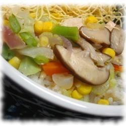 Chicken Chow Mein Recipe - A mild yet pleasing dish: chicken with baby corn, mushrooms, onions and celery in a thickened broth over rice or crispy noodles.