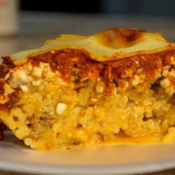 Baked Spaghetti Casserole Recipe - This baked spaghetti casserole has layers of pasta, cottage cheese, spaghetti sauce, and mozzarella cheese.