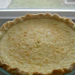 Coconut Custard Pie III Recipe - This is a thick, creamy and wonderfully sweet custard pie filled with lots of coconut. It bakes up beautifully and is terrific served with unsweetened whipped cream with a dusting of nutmeg.