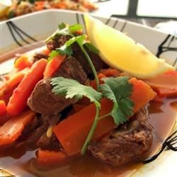 Lamb Tagine Recipe - This is a traditional Moroccan lamb tagine simmered in numerous spices.  Don't let the long ingredients list put you off.  If you are missing one or two the dish will still turn out fine.