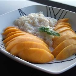 Thai Sweet Sticky Rice With Mango (Khao Neeo Mamuang) Recipe - Sweetened coconut milk flavors sticky rice, which is then served with fresh mango in this deliciously refreshing take on the traditional Thai treat.