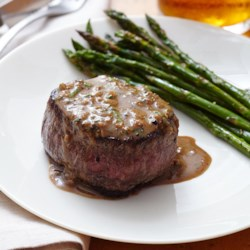 Oven-Seared Beef Tenderloin with Herb Pan Sauce Recipe - Oven-seared beef tenderloin steaks are topped with a rich, creamy sauce with beef stock and fresh herbs.