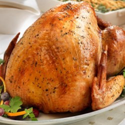 Herb Roasted Turkey with Pan Gravy Recipe - Here's an easy, reliable way to ensure a moist and flavorful turkey...simply baste the turkey with herb-seasoned chicken stock during roasting.  When the turkey is done, use a bit more stock to make a quick and savory gravy.