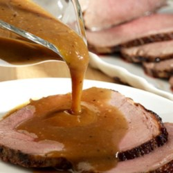 Beef Roast and Onion Gravy Recipe - Flavorful beef stock serves double-duty in this tasty recipe as it is used as a basting sauce for the roast and to make the savory onion-studded pan gravy.