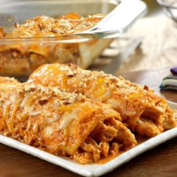 Spicy Chicken Enchiladas with Red Mole Sauce Recipe - What makes these enchiladas so good? The key to the exceptional flavor is the red mole sauce made from a delectable, pureed mixture featuring toasted almonds, onion, tomatoes, chipotle chiles, raisins and cinnamon.