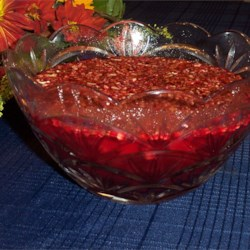 Cranberry Gelatin Salad I Recipe - In this salad, cranberry sauce and pineapple chunks are stirred into a gelatin base and sprinkled with chopped nuts.