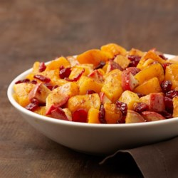 Butternut Squash with Apple and Cranberries Recipe - This hearty butternut squash recipe has all the warmth of fall wrapped into this one seasonally delicious dish!