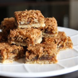 Coconut Walnut Squares Recipe - These squares are a tasty way to enjoy a treat. The combination of coconut with walnut makes these squares a delicious delight.