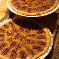 Sweet Potato Pecan Pie Recipe - A cinnamon, ginger, and nutmeg spiced sweet potato filling is sprinkled with chopped pecans in this pie which is served with a hazelnut liquer whipped cream topping.